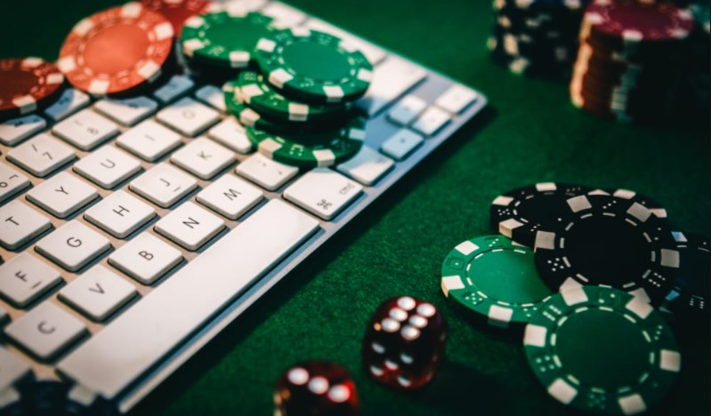 Casino table with a keyboard and casino chips on top